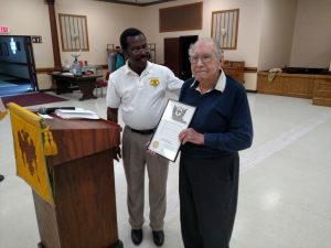 """Robert """"Bob"""" Schultz receives his 60 Year Membership Certificate from Commander-in-Chief Selom Adjogah at a recent Tuesday Lunch at the Valley."""